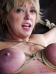Milf whipped in spread eagle rope bondage