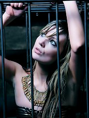 Hottie caged in bdsm dungeon | Shackled Maidens